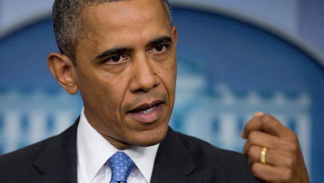President Obama speaks to reporters in the Brady briefing room.