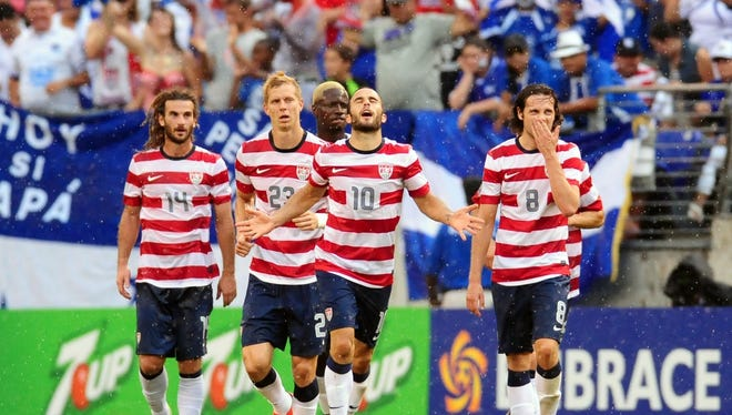 Donovan celebrates his goal in the 78th minute, which gave the U.S. a 4-1 lead.