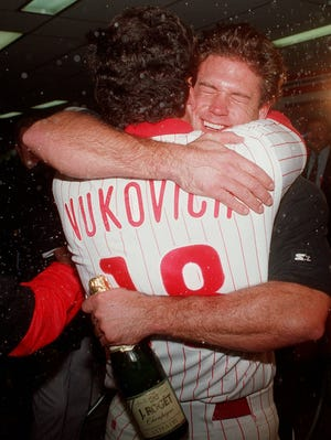 In this 1993 photo, Darren Daulton, currently battling brain cancer, hugs John Vukovich, who died in 2007 after a lengthy battle with brain cancer.