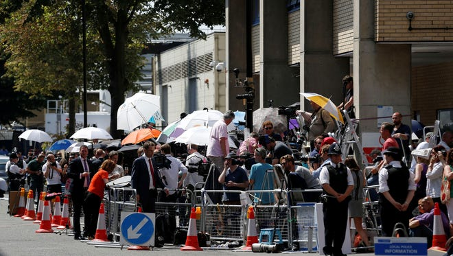 Journalists gather across from the Lindo Wing at St. Mary's Hospital in London on Monday.