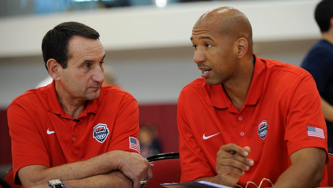 Team USA coach Mike Krzyzewski talks with assistant coach Monty Williams during the media access portion of opening day of the USA Basketball camp at Mendenhall Center.