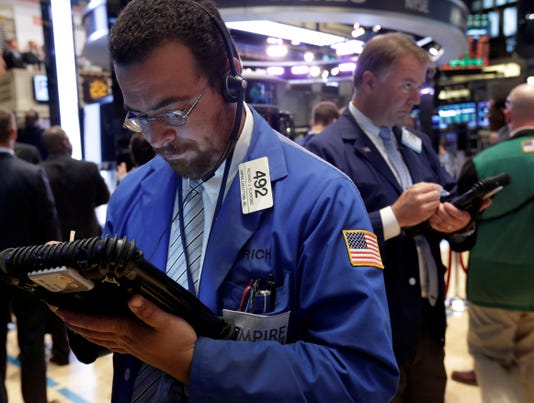 Dow sets record high in mixed day for stocks