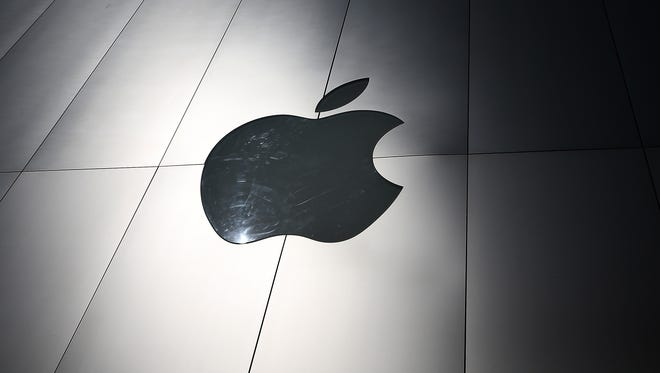 The Apple logo is displayed on the exterior of an Apple Store in San Francisco, Calif.