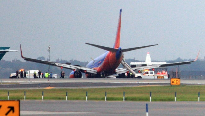 A Southwest Airlines flight slid to a halt Monday at New York's LaGuardia airport after its nose gear collapsed while landing. Federal investigators are searching for the cause.
