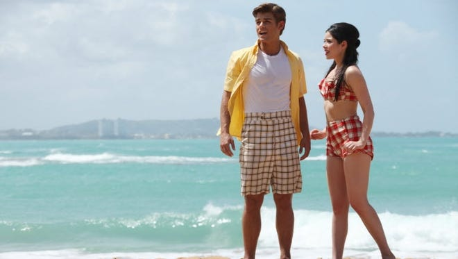 Disney's throwback 'Teen Beach Movie,' with Garrett Clayton  and Grace Phipps, drew a solid 7.7 million viewers, topping the first 'High School Musical' premiere.