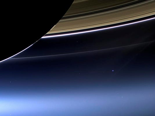 Say cheese: Saturn orbiter snaps rare photo of blue Earth