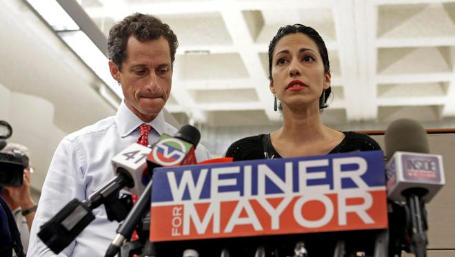 New York mayoral candidate Anthony Weiner listens as his wife, Huma Abedin, speaks during a news conference July 23 in New York.