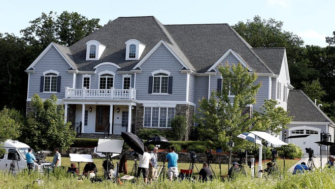 Members of the media stake out the house of New England Patriots tight end Aaron Hernandez in North Attleborough, Mass.