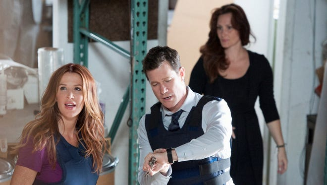 The Season 2 premiere of CBS' 'Unforgettable' sees Al (Dylan Walsh) and Carrie (Poppy Montgomery, left) moving from Queens to the Major Crimes Section of the NYPD in Manhattan.