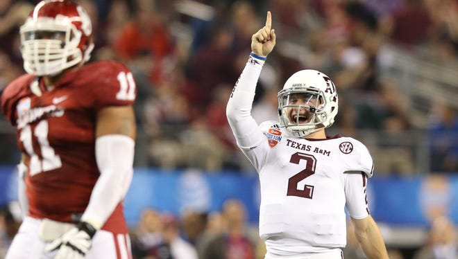 Texas A&M Aggies quarterback Johnny Manziel (2) celebrates a touchdown in the third quarter against the Oklahoma Sooners during the Cotton Bowl.