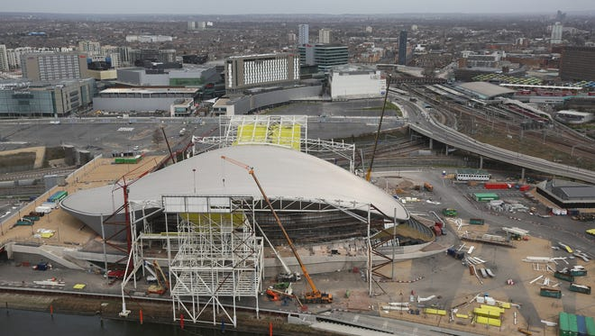 Workmen redevelop the Aquatics Center, which was used in the London Olympics, on April 16 in London.