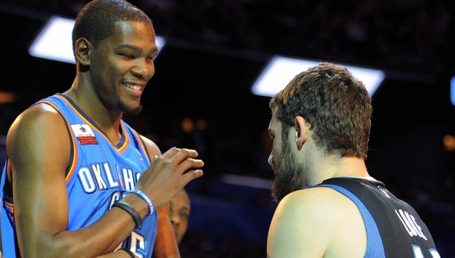 Kevin Love reacts to Kevin Durant in the 2012 NBA All-Star Three Point Contest at the Amway Center. Both have committed to play for Team USA next summer.