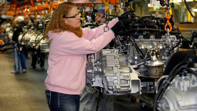 Tina Knudson works in engine assembly at the General Motors Fairfax Assembly and Stamping Plant in Kansas City, Kans.