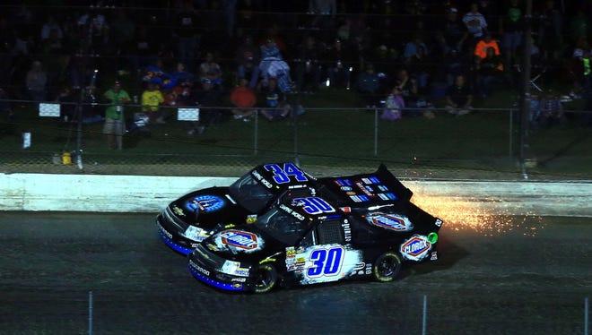 Ryan Newman (34) and Kyle Larson (30) trade paint during the Mudsummer Classic at Eldora Speedway.