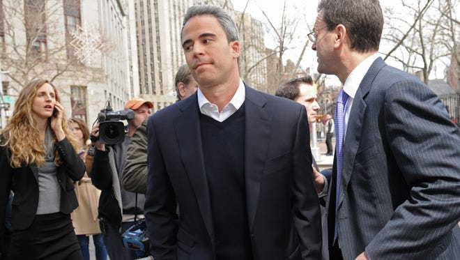 Michael Steinberg exits Manhattan federal court with his attorney Barry Berke on March 29 in New York. Steinberg has pleaded not guilty to conspiracy and securities fraud.