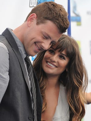 """This Aug. 19, 2012 file photo shows Cory Monteith, left, and Lea Michele at the 2012 Do Something awards in Santa Monica, Calif.  Monteith, who shot to fame in the hit TV series """"Glee"""" but was beset by addiction struggles so fierce that he once said he was lucky to be alive, was found dead in a Vancouver hotel room, police said. He was 31."""