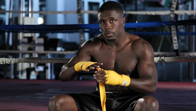 Andre Berto tapes his hands before a recent workout leading up to his fight Saturday with Jesus Soto-Karass.