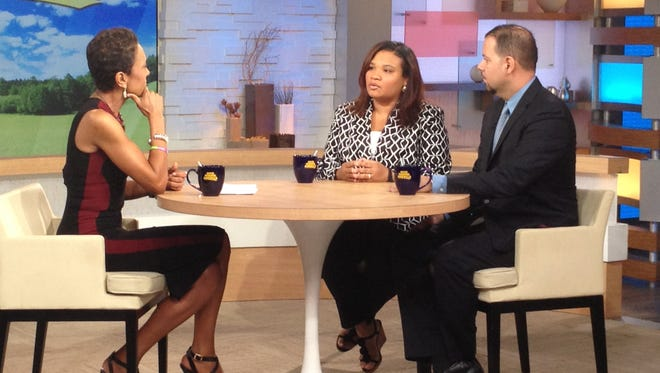 """ABC host Robin Roberts, left, chats with Juror B29 from the George Zimmerman trial, center, and attorney David Chico on """"Good Morning America,"""" in New York on July 25."""
