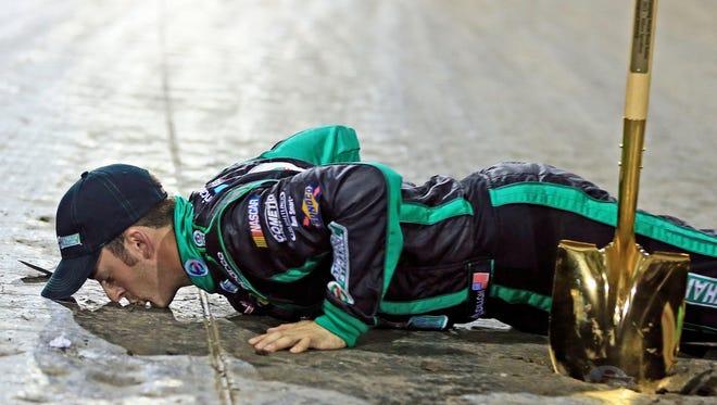 Austin Dillon kisses the dirt after winning the Mudsummer Classic at Eldora Speedway.
