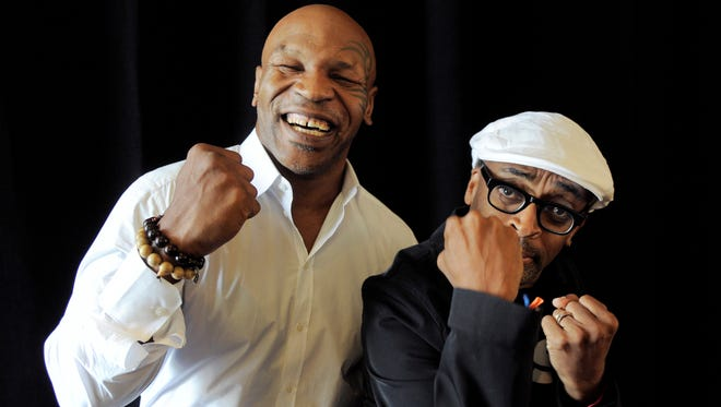 """Spike Lee, right, director of """"Mike Tyson: Undisputed Truth,"""" poses backstage with Tyson during an HBO event on Thursday"""