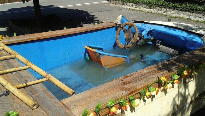 A car was been converted into a driveable pool  in? Eibenstock, Germany.