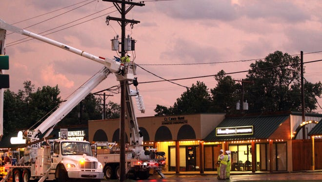 A power pole is worked on by Westar Energy employees July 23, 2013, in Hutchinson, Kan.