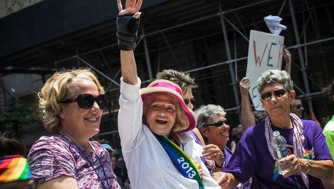 Edie Windsor, who successfully sued the United States government over the constitutionality of the Defense of Marriage Act (DOMA), waves to revelers while riding in the New York Gay Pride Parade on June 30 in New York City.