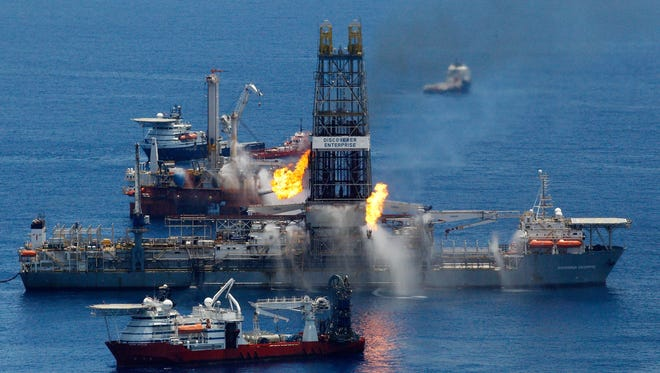 The Transocean Discoverer Enterprise drillship burns off gas collected at the BP Deepwater Horizon oil spill in the Gulf of Mexico off the coast of Louisiana on June 25, 2010.