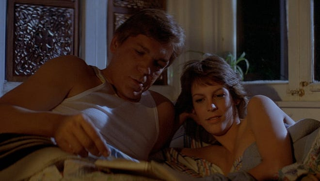 """Nick (Tom Atkins) and Elizabeth (Jamie Lee Curtis) enjoy an intimate moment before the weirdness hits in """"The Fog."""""""