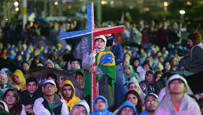 People attend the welcoming ceremony offered by the youth for Pope Francis during the World Youth Day ceremonies on July 25 at Copacabana Beach in Rio de Janeiro.