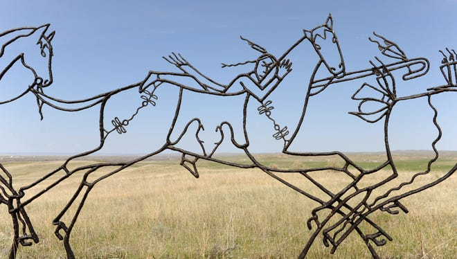 """The """"Peace Through Unity"""" memorial at Little Bighorn features three Indian warriors riding into battle."""