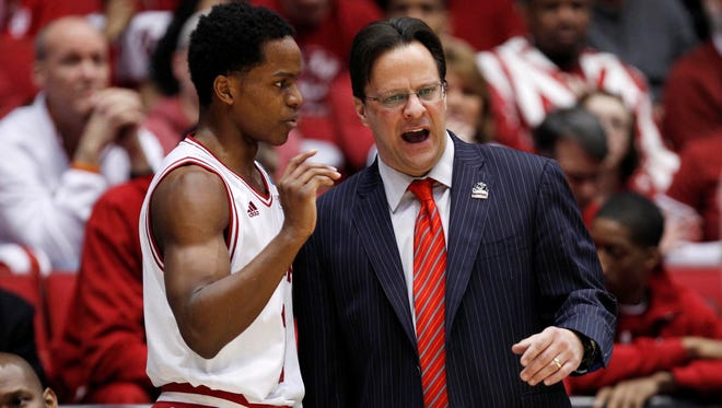 Indiana coach Tom Crean talks to guard Nkereuwem Okoro (11) in the first half against Temple during the third round of the 2013 NCAA Tournament at University of Dayton Arena.