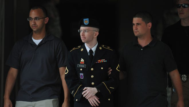Army Pfc. Bradley Manning is escorted from court on July 25 at Fort Meade, Md.