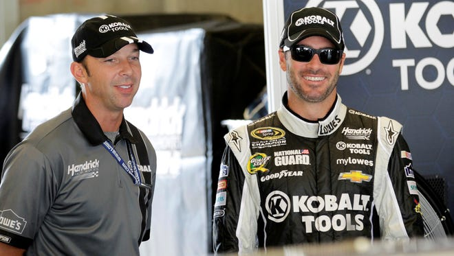 Jimmie Johnson and Chad Knaus share a lighter moment during Brickyard 400 practice at Indianapolis Motor Speedway.