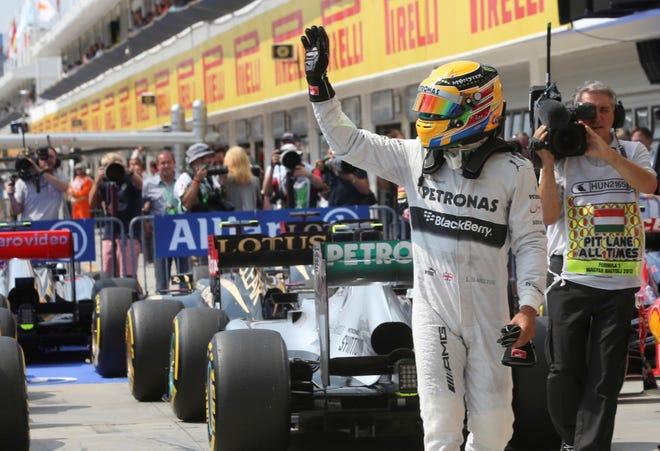 Lewis Hamilton waves to spectators after grabbing the pole position for Sunday's Hungarian Grand Prix.