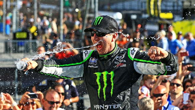 Kyle Busch celebrates after winning the Indiana 250 Nationwide Series race Saturday at Indianapolis Motor Speedway.
