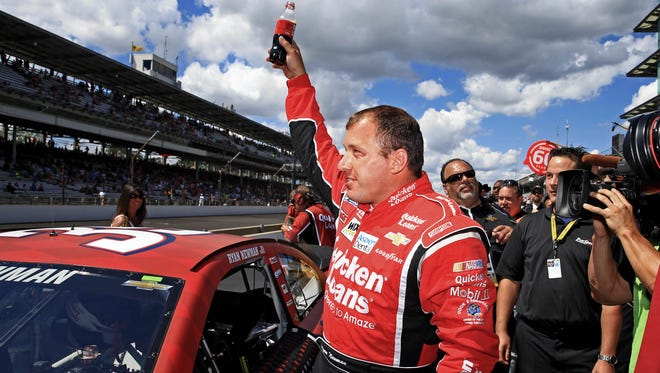 Ryan Newman exits his car after winning the pole for the Samuel Deeds 400 at the Brickyard.