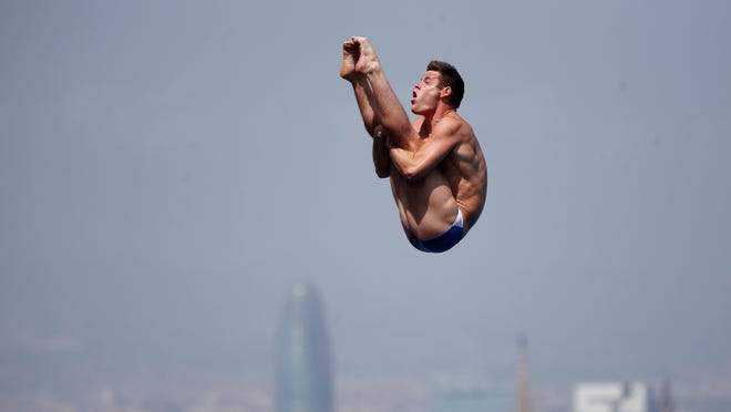 David Boudia from U.S. performs during the men's 10-meter platform semi final at the FINA Swimming World Championships in Barcelona, Spain, Saturday, July 27, 2013.