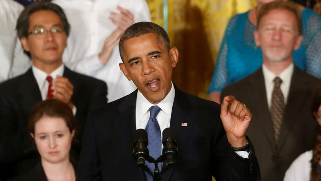 President Obama spoke about lower insurance rates at the White House on July 18.