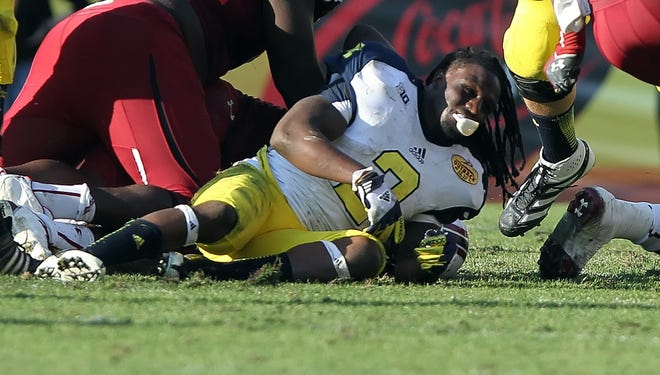The hit by South Caroilna defensive end Jadaveon Clowney in the 2013 Outback Bowl that left Michigan running back Vincent Smith without his helmet could result in an ejection this season.