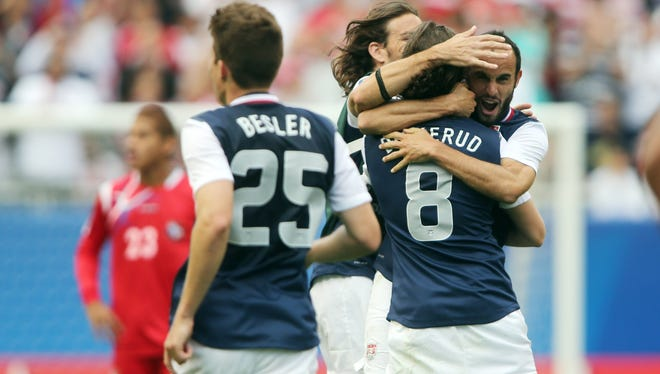 USA players celebrate after defeating Panama in the 2013 Gold Cup championship game at Soldier Field.