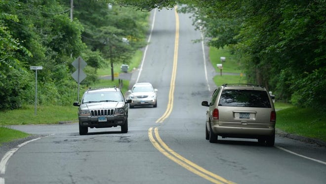"""This hilly, winding road that's cracked and recessed on the edges is in New Fairfield, Conn.  Connecticut has the nation's second-highest percentage of major roads with pavement in """"poor"""" condition."""
