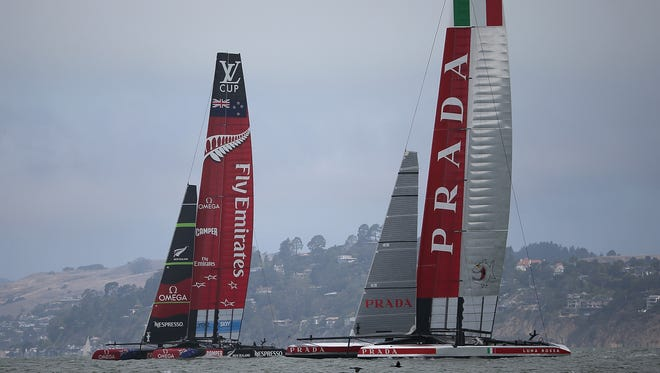 Team Luna Rossa Challenge (right) skippered by Massimiliano Sirena and Emirates Team New Zealand (left) skippered by Dean Barker practice before the start the Louis Vuitton Cup Round Robin 5 on Sunday in San Francisco.