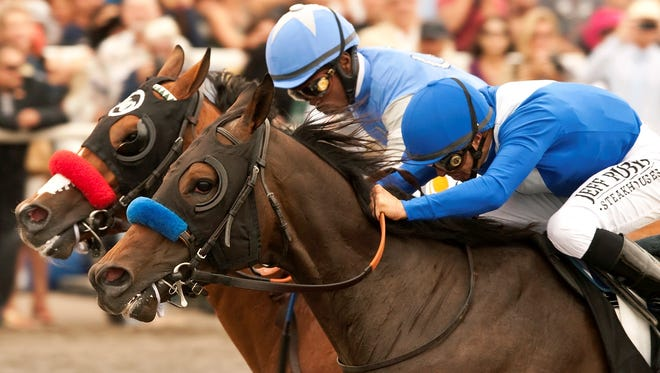Points Offthebench and jockey Mike Smith, right, held off Goldencents, with Kevin Krigger,  to win the Grade I, Bing Croby Handicap Sunday at Del Mar