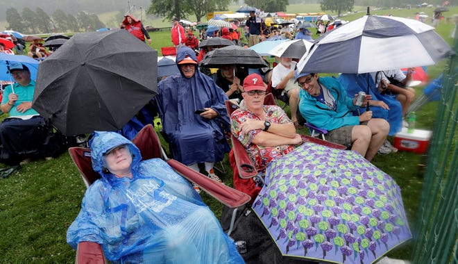 With no living players elected to the Hall of Fame, largely due to backlash from baseball's steroid era, just 2,500 fans braved the rain for Sunday's ceremonies.