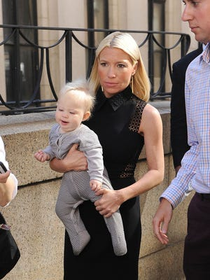 Celebrity fitness trainer Tracy Anderson .carries daughter Penelope Mogol on April 30 in New York City.