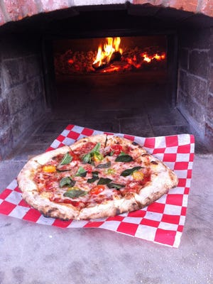 At Suncrest Gardens, fresh-picked ingredients go onto the pizzas, which are cooked in a brick oven.
