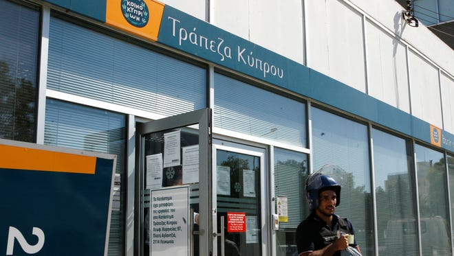 Cyprusí government says depositors at the bailed-out countryís largest lender will lose a total 47.5 percent of their savings over 100,000 euros.