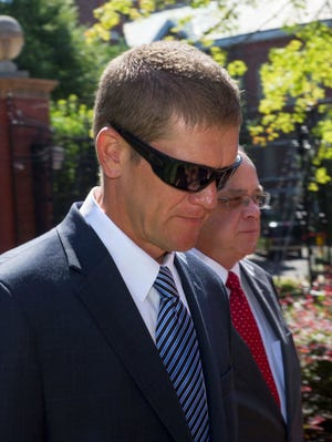 Former Pilot Flying J executive Scott Fenwick leaves court after pleading guilty in connection with a federal investigation into alleged fuel rebate fraud on Monday, July 29, 2013, in Knoxville, Tenn. Fenwick, a former regional sales manager based in Salt Lake City, Utah, admitted to a charge of conspiracy to commit mail fraud.