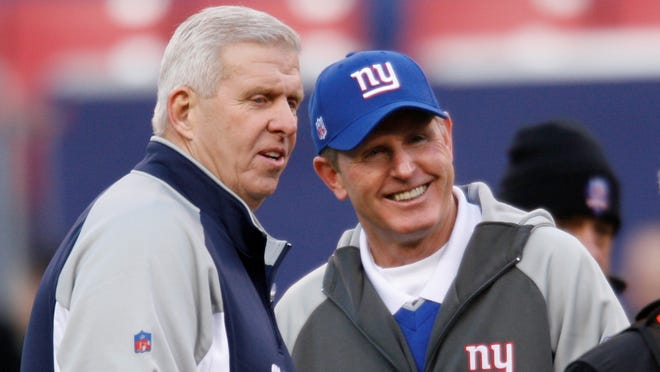 In December 2006, Dallas Cowboys head coach Bill Parcells and New York Giants head coach Tom Coughlin meet pre-game.